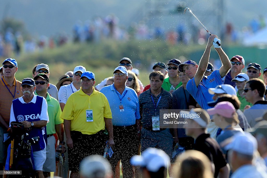 <a gi-track='captionPersonalityLinkClicked' href=/galleries/search?phrase=Jim+Furyk&family=editorial&specificpeople=202579 ng-click='$event.stopPropagation()'>Jim Furyk</a> of the United States hits a shot on the 11th hole during Round One of the 94th PGA Championship at the Ocean Course on August 9, 2012 in Kiawah Island, South Carolina.