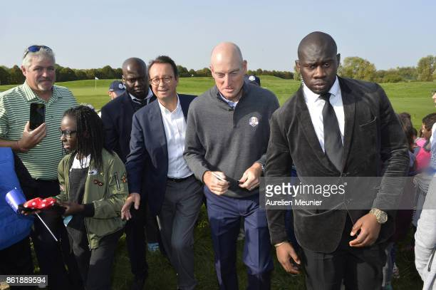 Jim Furyk of the United States of America Captain of the Ryder Cup 2018 signs autographs during the Captain's Challenge at Golf National on October...