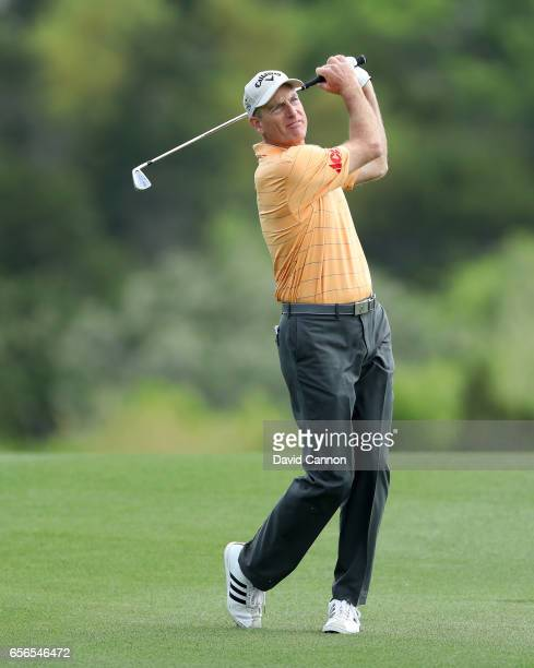 Jim Furyk of the United States plays his second shot on the par 4 second hole in his match against Hideki Matsuyama during the first round of the...