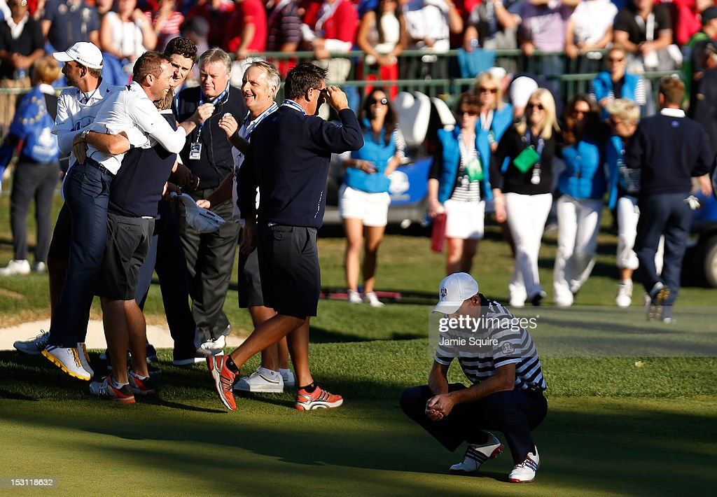 <a gi-track='captionPersonalityLinkClicked' href=/galleries/search?phrase=Jim+Furyk&family=editorial&specificpeople=202579 ng-click='$event.stopPropagation()'>Jim Furyk</a> of the USA (R) reacts to a missed par putt on the 18th green as Sergio Garcia and the European team celebrate during the Singles Matches for The 39th Ryder Cup at Medinah Country Club on September 30, 2012 in Medinah, Illinois.