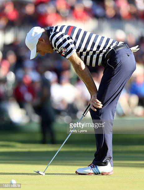 Jim Furyk of the USA reacts to a missed par putt on the 18th green during the Singles Matches for The 39th Ryder Cup at Medinah Country Club on...