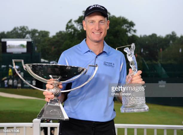 Jim Furyk poses with the tournament trophy and the FedEx Cup after winning THE TOUR Championship presented by CocaCola the final event of the PGA...