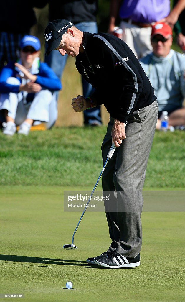 <a gi-track='captionPersonalityLinkClicked' href=/galleries/search?phrase=Jim+Furyk&family=editorial&specificpeople=202579 ng-click='$event.stopPropagation()'>Jim Furyk</a> pumps his fist as his ball falls in for a birdie on the fourth green during the Second Round of the BMW Championship at Conway Farms Golf Club on September 13, 2013 in Lake Forest, Illinois.