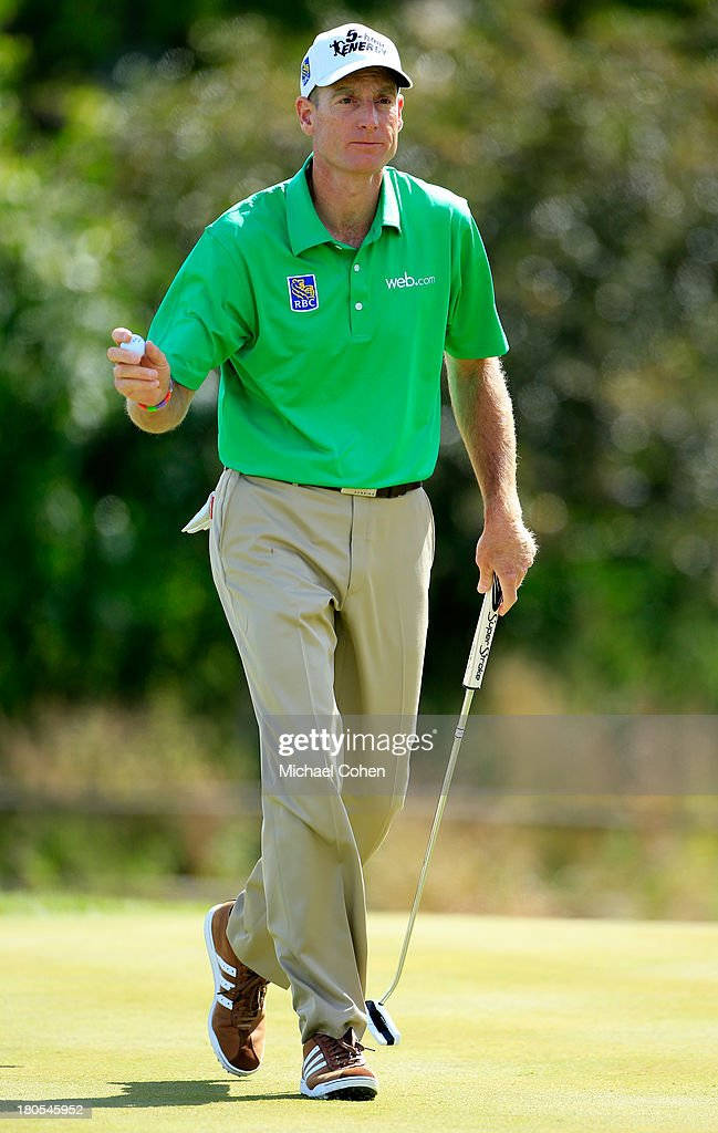 <a gi-track='captionPersonalityLinkClicked' href=/galleries/search?phrase=Jim+Furyk&family=editorial&specificpeople=202579 ng-click='$event.stopPropagation()'>Jim Furyk</a> reacts after a putt on the seventh green during the Third Round of the BMW Championship at Conway Farms Golf Club on September 14, 2013 in Lake Forest, Illinois.