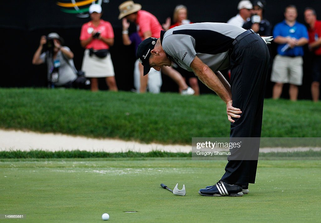 <a gi-track='captionPersonalityLinkClicked' href=/galleries/search?phrase=Jim+Furyk&family=editorial&specificpeople=202579 ng-click='$event.stopPropagation()'>Jim Furyk</a> reacts to a missed missed bogie attempt on the 18th green to loose the World Golf Championships-Bridgestone Invitational to Keegan Bradley at Firestone Country Club South Course on August 5, 2012 in Akron, Ohio.