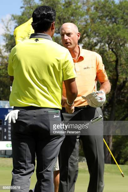 Jim Furyk shakes hands with Hideki Matsuyama of Japan after they halved their match during round one of the World Golf ChampionshipsDell Technologies...