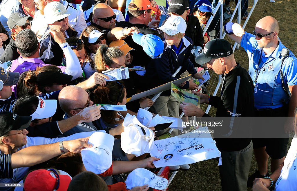 Jim Furyk signs autographs after shooting a 12 under round of 59 during the Second Round of the BMW Championship at Conway Farms Golf Club on September 13, 2013 in Lake Forest, Illinois.