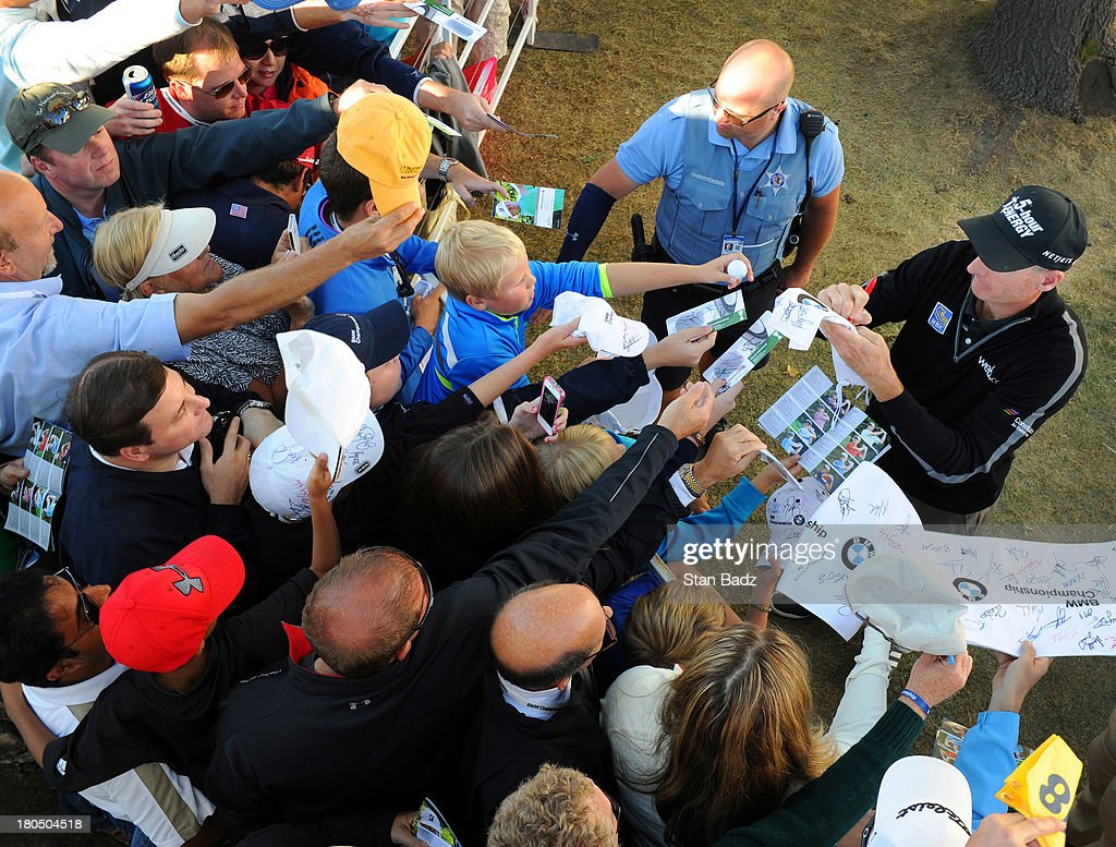 Jim Furyk signs autographs for fans after shooting a score of 59 during the second round of the BMW Championship at Conway Farms Golf Club on September 13, 2013 in Lake Forest, Illinois.