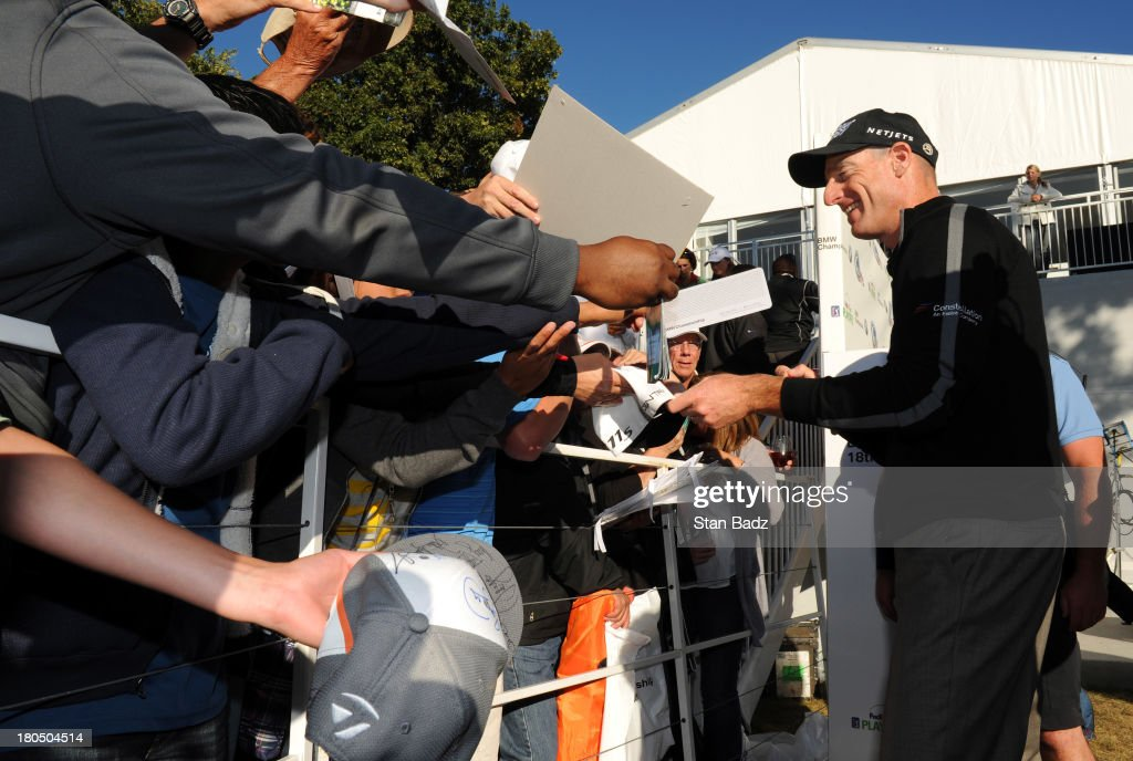 Jim Furyk smiles as he signs autographs for fans after shooting a score of 59 during the second round of the BMW Championship at Conway Farms Golf Club on September 13, 2013 in Lake Forest, Illinois.