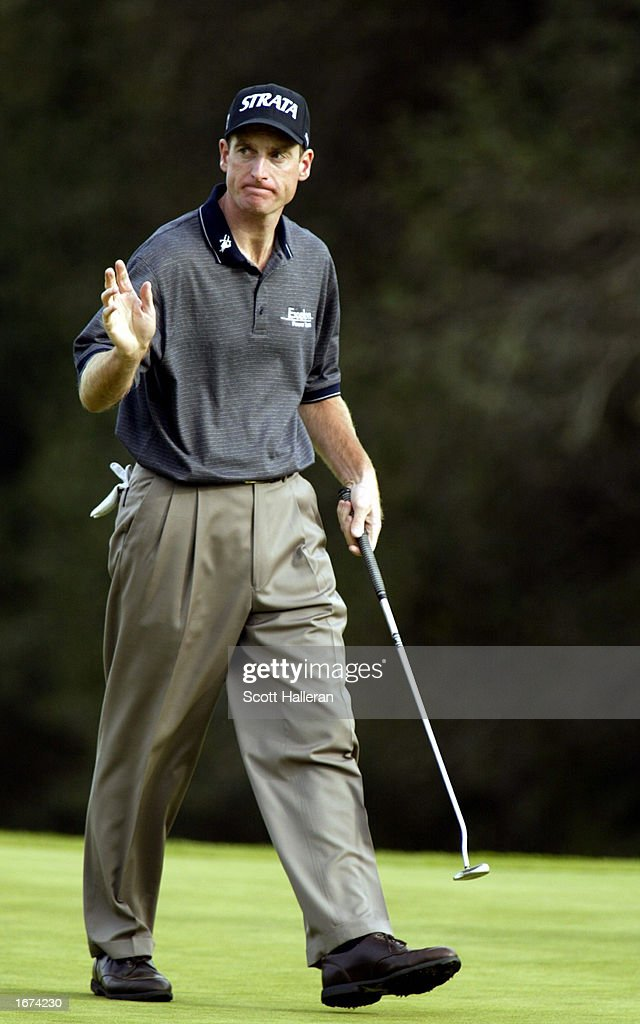 Jim Furyk waves to the gallery after a birdie on the 18th green during the first round of the Target World Challenge on December 5, 2002 at Sherwood Country Club in Thousand Oaks, California.