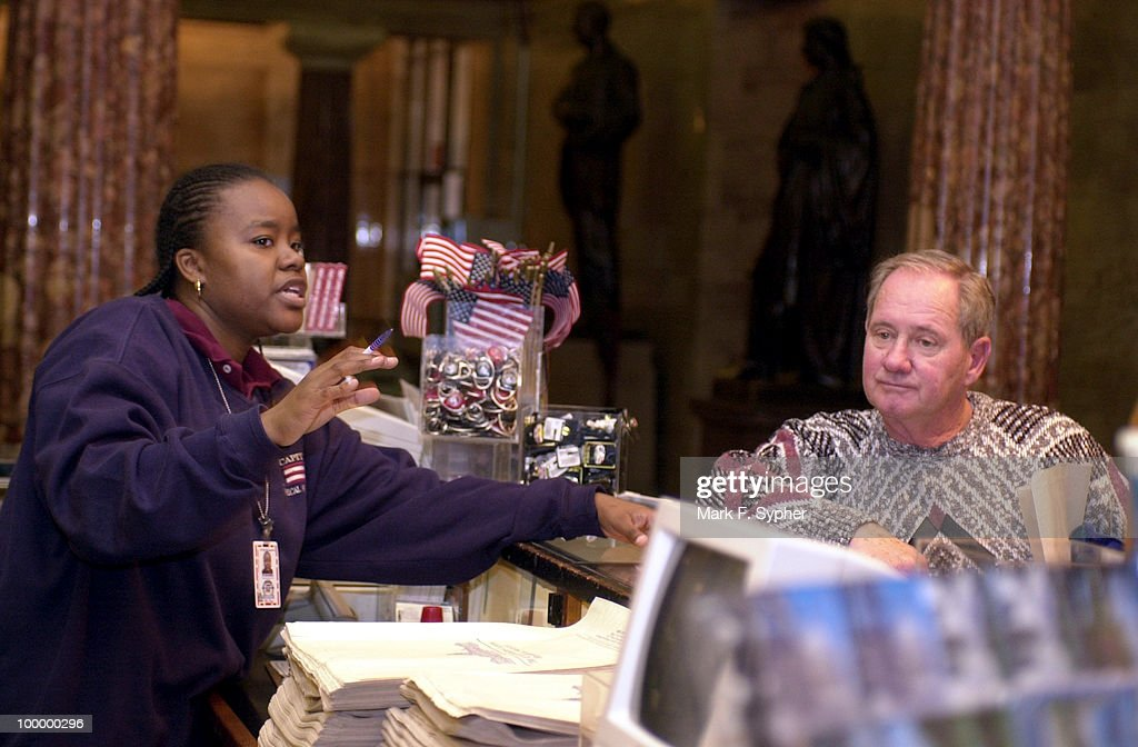 Jim Gallagher, from Thousand Oaks, Calif. gets redirected by Zabrina Smith, who has worked at the U.S. Capitol gift shop for two years.