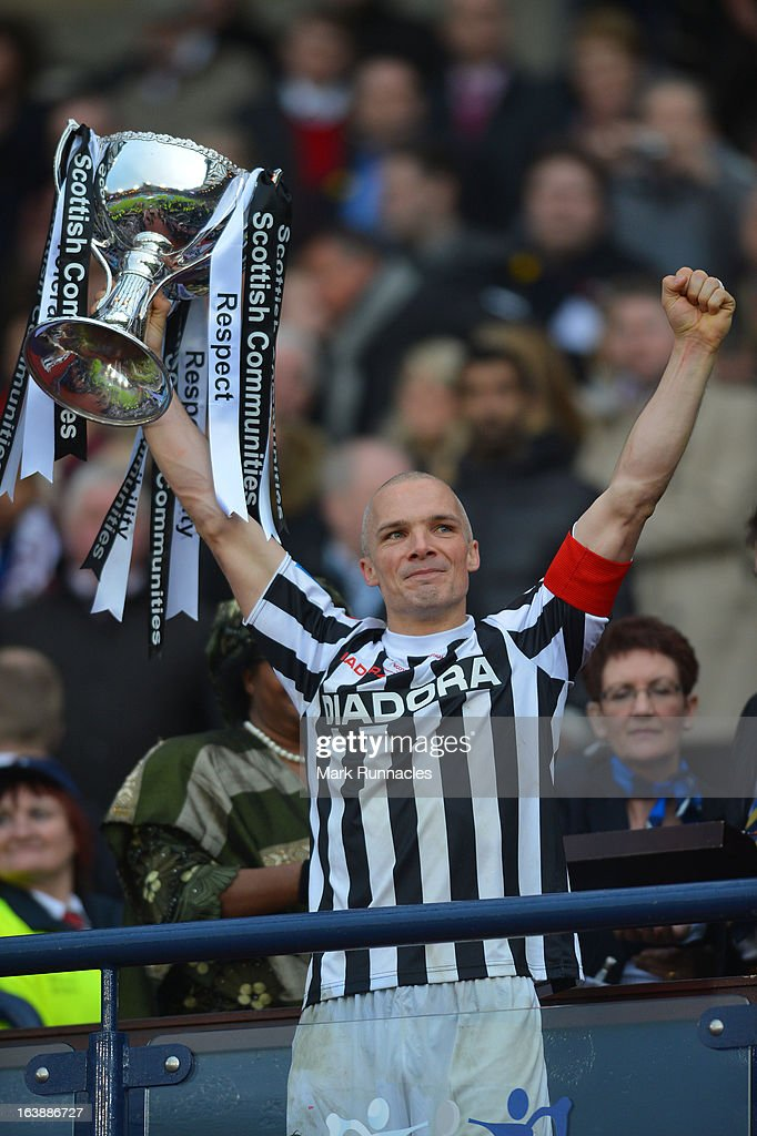 Jim Goodwin of St Mirren celebrates with the Scottish Communities League Cup after victory in the Scottish Communities League Cup Final between St Mirren and Hearts at Hampden Park on March 17, 2013 in Glasgow, Scotland.