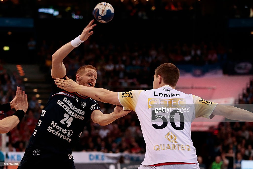 Jim Gottfridsson (L) of Flensburg challenges for the ball with Finn Lemke (R) of Magdeburg during the DKB REWE Final Four Finale 2016 between SG Flensburg Handewitt and SC Magdeburg at Barclaycard Arena on May 1, 2016 in Hamburg, Germany.
