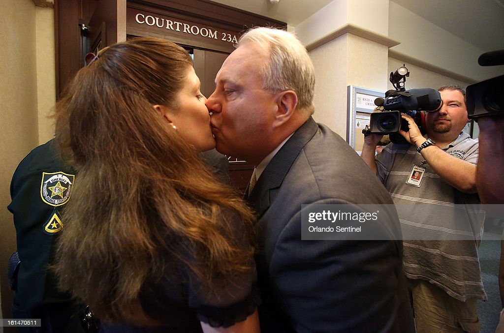 Jim Greer, center, ousted former Florida GOP chairman, kisses his wife Lisa as he enters an Orange County courtroom before entering a surprise guilty plea to five criminal charges, Monday, February 11, 2013. Greer, 50, was facing a possible 75 years in prison for fraud, money laundering and theft. Now he faces a possible maximum sentence of 35 years.