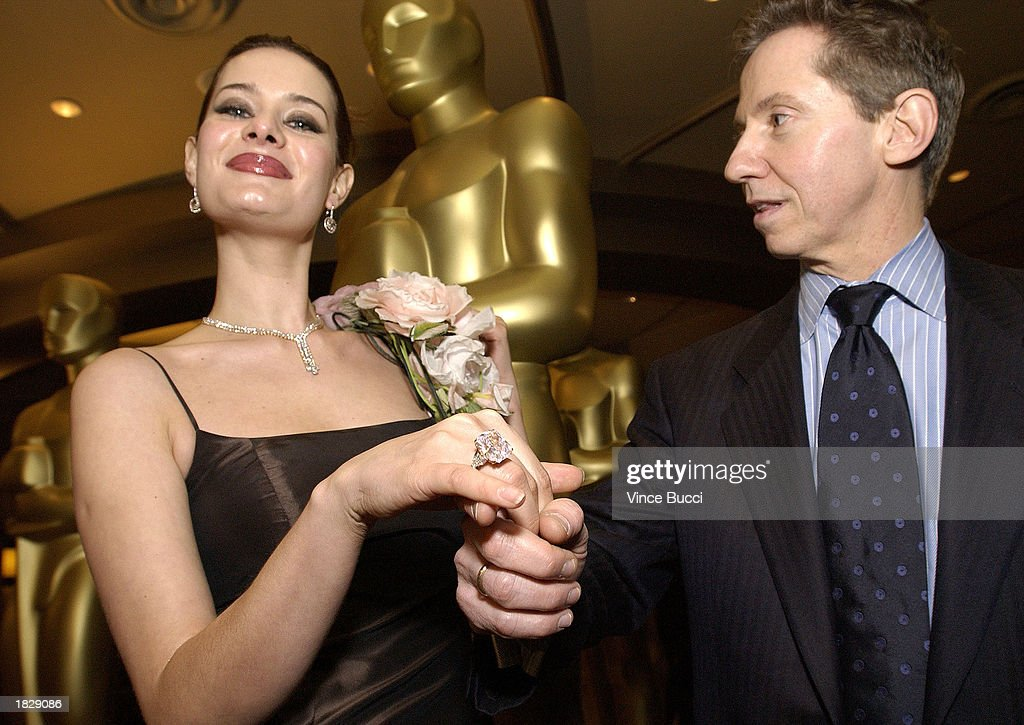 Jim Haag of Harry Winston jewelers (R) holds a model's hand as she wears a 27-carat pink diamond ring valued at over $8 million dollars after the 2003 Oscar Fashion Preview at the Kodak Theatre on March 4, 2003 in Hollywood, California.