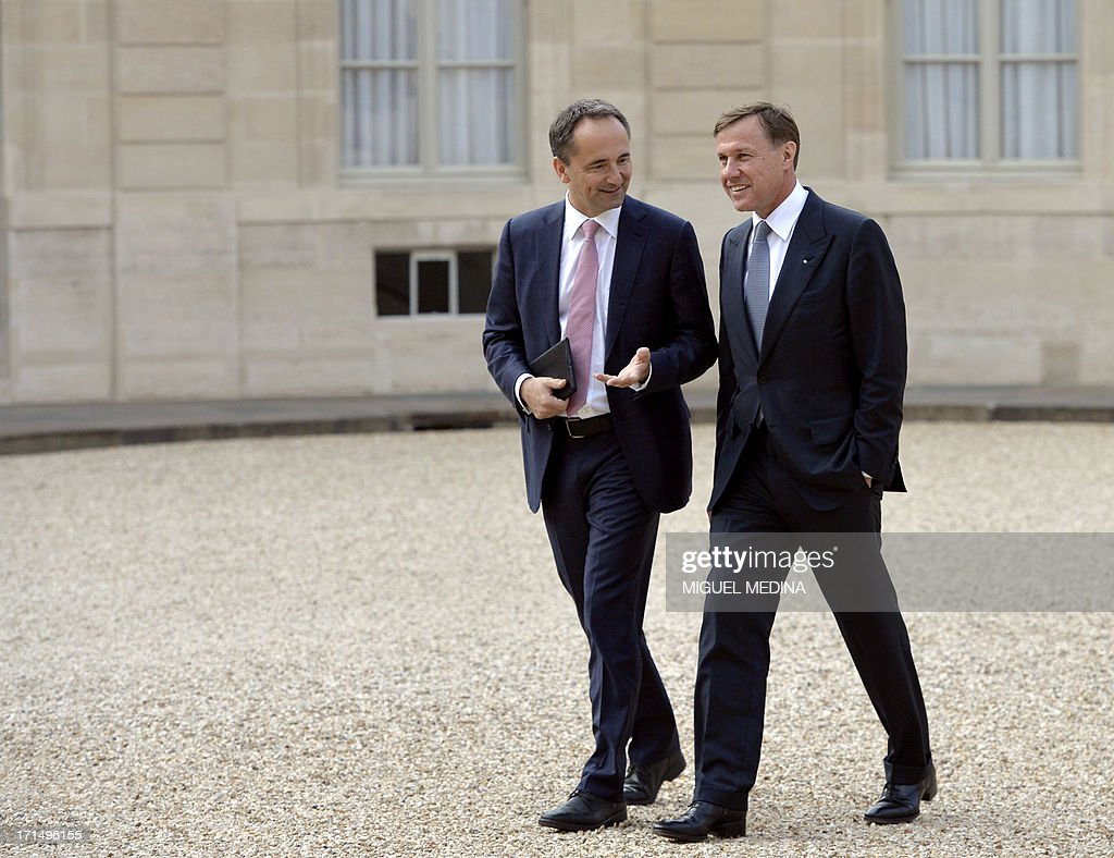 Jim Hagemann Snabe (L) of Germany, co-CEO of German software maker SAP and Martin Senn of Switzerland, Chief Executive Officer at Zurich Insurance arrive at the Elysee Palace for a dinner organized with the World Economic Forum in Davos with leaders of major international companies and French President at the Elysee Palace in Paris on June 25, 2013. AFP PHOTO / MIGUEL MEDINA