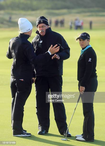 Jim Haley of the USA LPGA Tour referee remonstrates with players Suzannn Pettersen of Norway and Cristie Kerr of the USA as the players were asking...