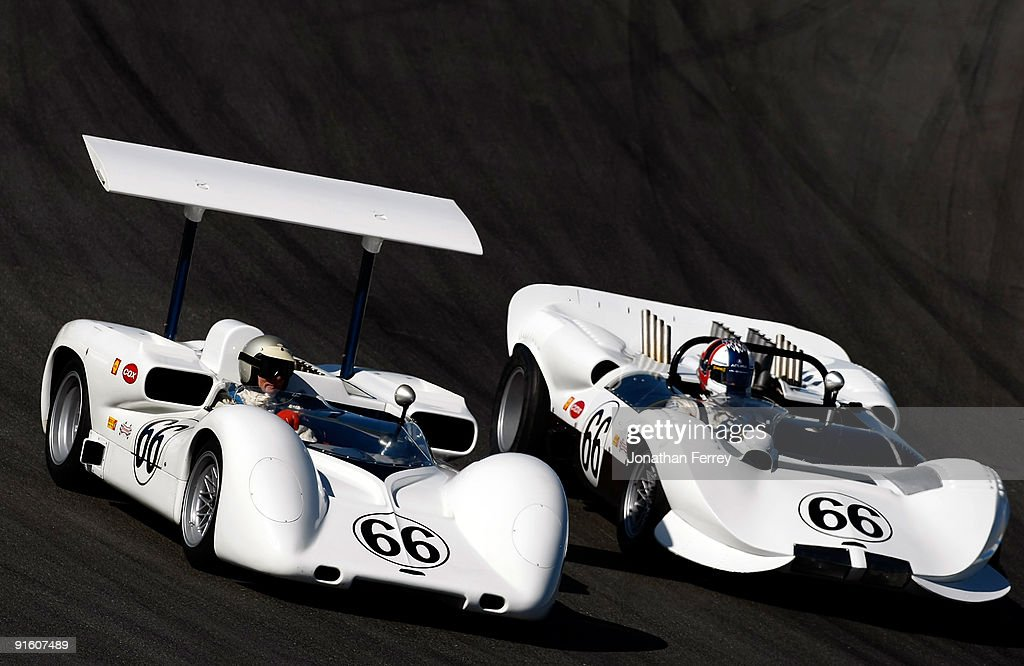 Jim Hall drives his Chaparral 2E ahead of Gil de Ferran the Chaparral during a demonstration lap before practice for the ALMS Monterey Sports Car...