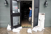 Jim Hand owner of Fred's Tavern and Liquor Store lets water out of his store after it floodedduring a blizzard January 23 2016 in Stone Harbor New...