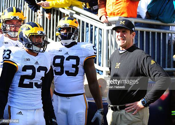 Jim Harbaugh head coach of the Michigan Wolverines looks on prior to the game against the Penn State Nittany Lions at Beaver Stadium on November 21...