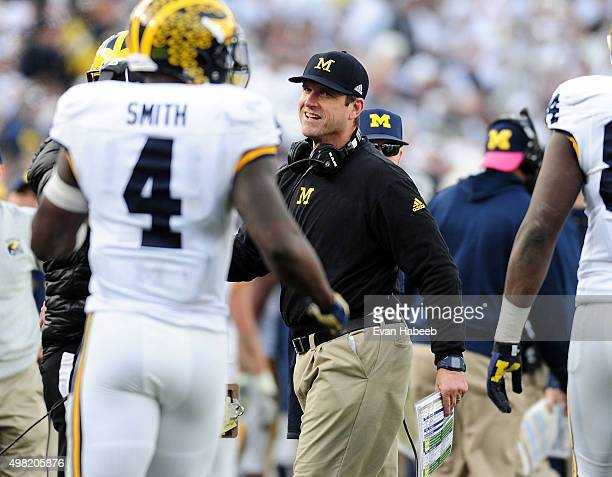 Jim Harbaugh head coach of the Michigan Wolverines reacts after De'Veon Smith scores a touchdown in the fourth quarter against the Penn State Nittany...