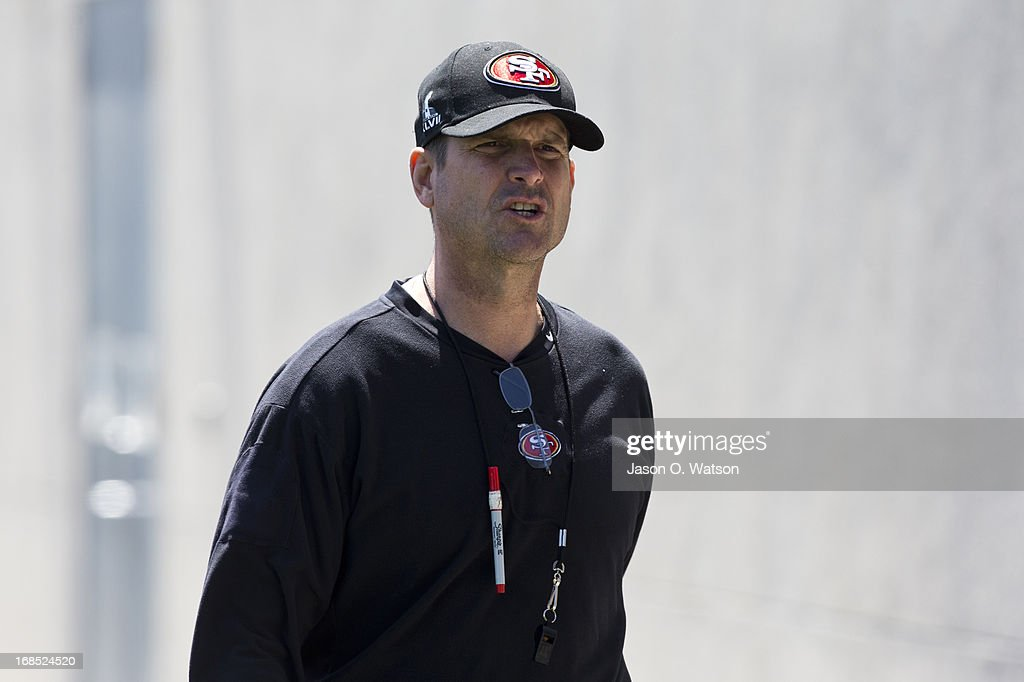 Jim Harbaugh head coach of the San Francisco 49ers enters the practice field during the San Francisco 49ers rookie minicamp at their training facility on May 10, 2013 in Santa Clara, California. Photo by Jason O. Watson/Getty Images)