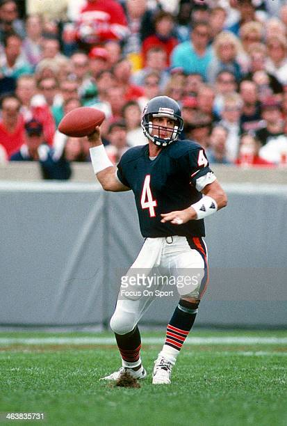 Jim Harbaugh of the Chicago Bears drops back to pass against the Detroit Lions during an NFL football game September 6 1992 at Soldier Field in...