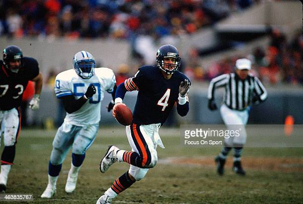 Jim Harbaugh of the Chicago Bears scrambles with the ball against the Detroit Lions during an NFL football game December 10 1990 at Soldier Field in...
