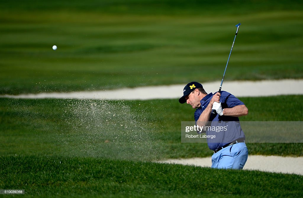 <a gi-track='captionPersonalityLinkClicked' href=/galleries/search?phrase=Jim+Harbaugh&family=editorial&specificpeople=779595 ng-click='$event.stopPropagation()'>Jim Harbaugh</a> plays a shot from the bunker on the fourth hole during round three of the AT&T Pebble Beach National Pro-Am at the Pebble Beach Golf Links on February 13, 2016 in Pebble Beach, California.