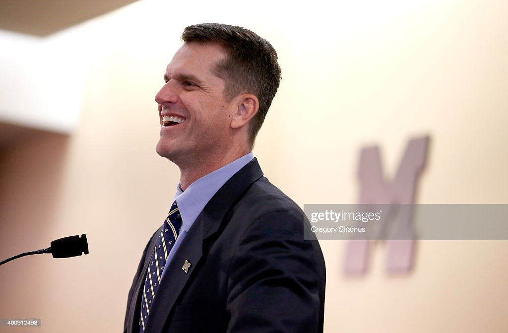 <a gi-track='captionPersonalityLinkClicked' href=/galleries/search?phrase=Jim+Harbaugh&family=editorial&specificpeople=779595 ng-click='$event.stopPropagation()'>Jim Harbaugh</a> speaks as he is introduced as the new Head Coach of the University of Michigan football team at the Junge Family Champions Center on December 30, 2014 in Ann Arbor, Michigan.