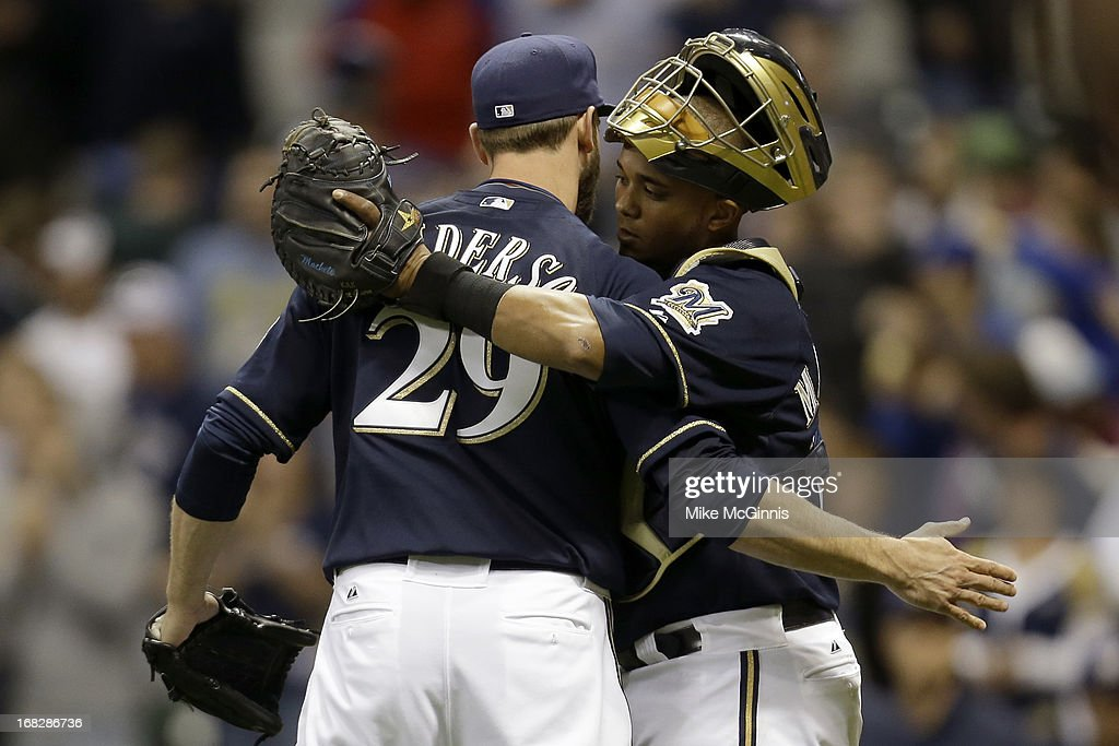 Jim Henderson #29 of the Milwaukee Brewers celebrates with Martin Maldondo #12 after the 6-3 win over the Texas Ranger during the game at Miller Park on May 07, 2013 in Milwaukee, Wisconsin.