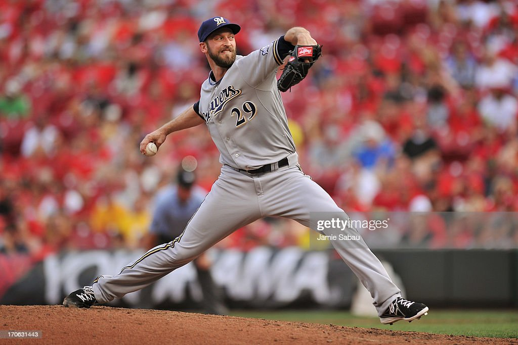 Jim Henderson #29 of the Milwaukee Brewers pitches in the ninth inning against the Cincinnati Reds at Great American Ball Park on June 15, 2013 in Cincinnati, Ohio. Milwaukee blanked Cincinnati 6-0.