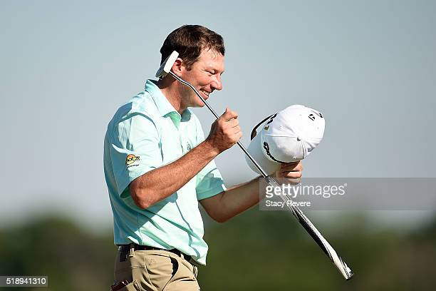 Jim Herman of the United States celebrates his victory on the 18th green during the final round of the Shell Houston Open at the Golf Club of Houston...
