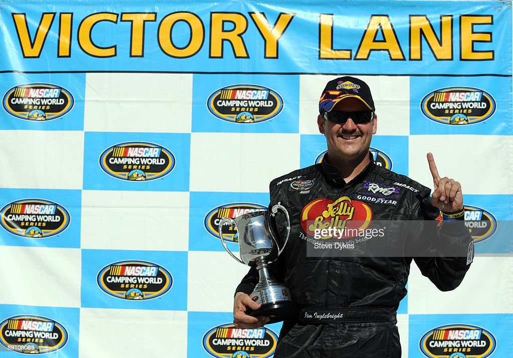 Jim Inglebright poses with the trophy after winning the NASCAR Camping World Series West BI-MART Salute to the Troops 125 at Portland International Raceway on July 19, 2009 in Portland, Oregon.