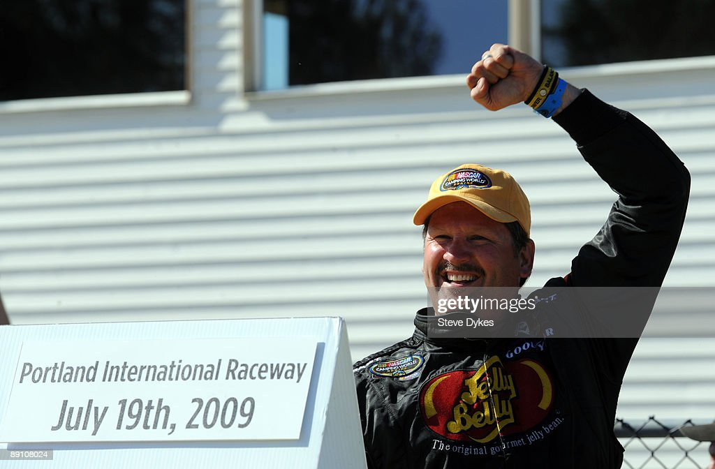 Jim Inglebright pumps his fist as he climbs out of the car after winning the NASCAR Camping World Series West BI-MART Salute to the Troops 125 at Portland International Raceway on July 19, 2009 in Portland, Oregon.