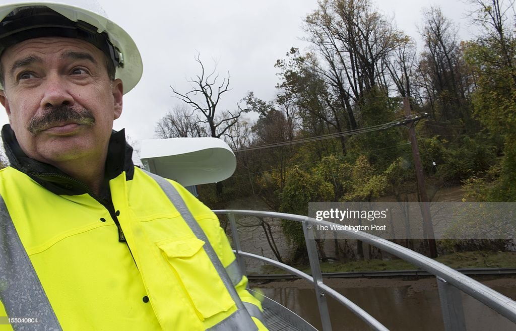 Jim Irvin, Howard Co Dir. of Public Works, on Oct. 30 at the Little Patuxent Water Reclamation Plant in Savage, MD. The plant went down during Hurricane Sandy after it lost power, forcing millions of gallons of untreated sewage into the Little Patuxent River. Behind Irvin is the area where it overflowed into the river.