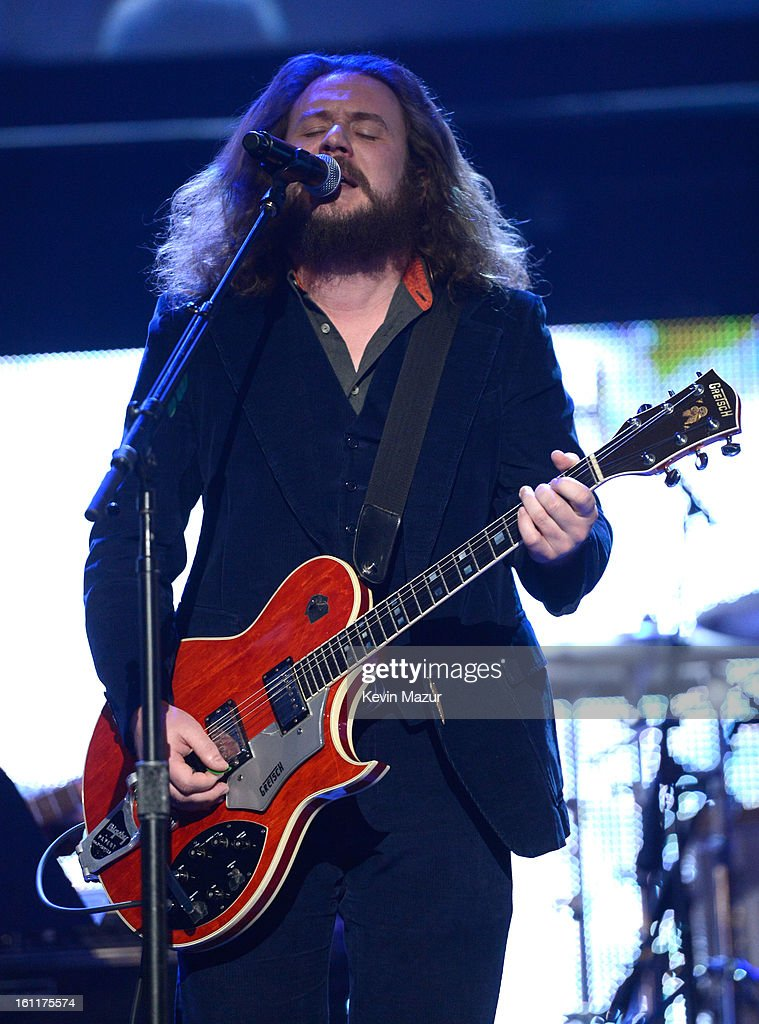 Jim James and Tom Morello perform onstage at MusiCares Person Of The Year Honoring Bruce Springsteen at Los Angeles Convention Center on February 8, 2013 in Los Angeles, California.