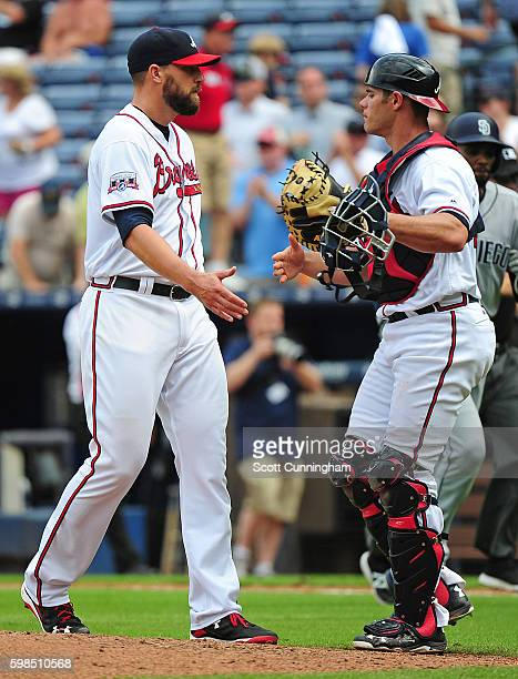 Jim Johnson and Anthony Recker of the Atlanta Braves celebrate after the game against the San Diego Padres at Turner Field on September 1 2016 in...