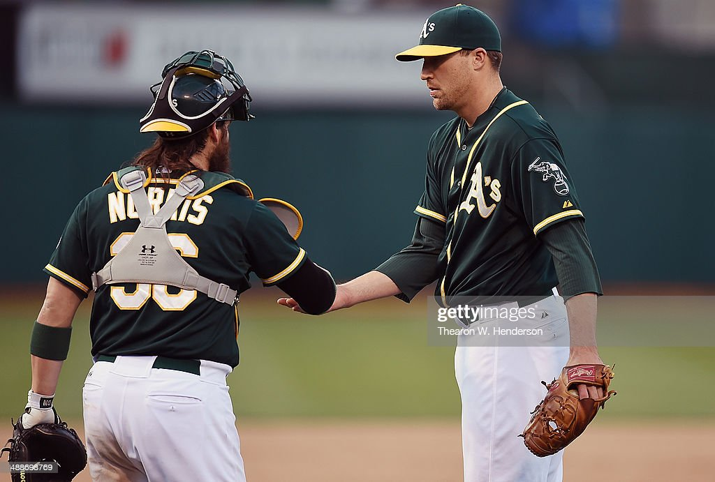 Jim Johnson #45 and <a gi-track='captionPersonalityLinkClicked' href=/galleries/search?phrase=Derek+Norris&family=editorial&specificpeople=6795804 ng-click='$event.stopPropagation()'>Derek Norris</a> #36 of the Oakland Athletics celebrates defeating the Seattle Mariners 2-0 at O.co Coliseum during game two of a doubleheader on May 7, 2014 in Oakland, California.