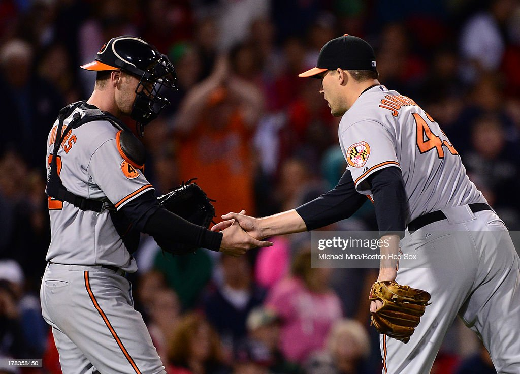 Jim Johnson #43 and <a gi-track='captionPersonalityLinkClicked' href=/galleries/search?phrase=Matt+Wieters&family=editorial&specificpeople=4498276 ng-click='$event.stopPropagation()'>Matt Wieters</a> #32 of the Baltimore Orioles celebrate a 3-2 victory over the Boston Red Sox on August 29, 2013 at Fenway Park in Boston Massachusetts.