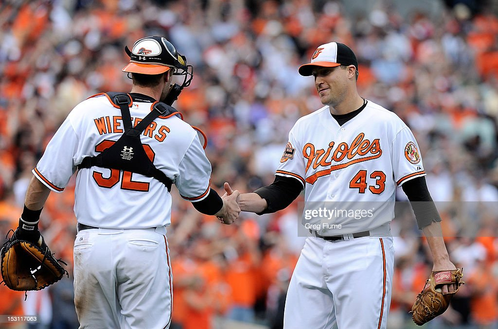 Jim Johnson #43 and <a gi-track='captionPersonalityLinkClicked' href=/galleries/search?phrase=Matt+Wieters&family=editorial&specificpeople=4498276 ng-click='$event.stopPropagation()'>Matt Wieters</a> #32 of the Baltimore Orioles celebrate after a 6-3 victory against the Boston Red Sox at Oriole Park at Camden Yards on September 30, 2012 in Baltimore, Maryland.