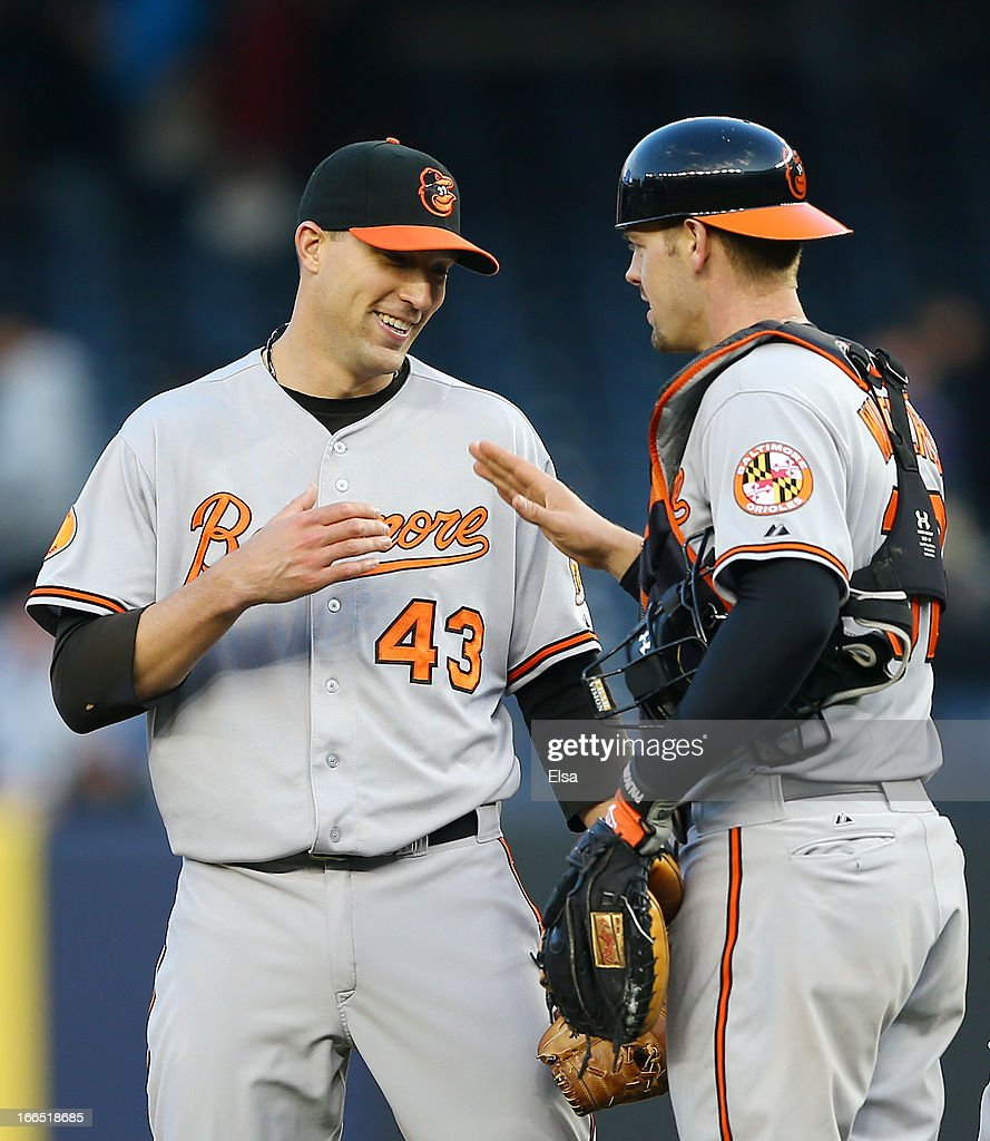 Jim Johnson #43 and <a gi-track='captionPersonalityLinkClicked' href=/galleries/search?phrase=Matt+Wieters&family=editorial&specificpeople=4498276 ng-click='$event.stopPropagation()'>Matt Wieters</a> #32 of the Baltimore Orioles celebrate the win over the New York Yankees on April 13, 2013 at Yankee Stadium in the Bronx borough of New York City.The Baltimore Orioles defeated the New York Yankees 5-3.