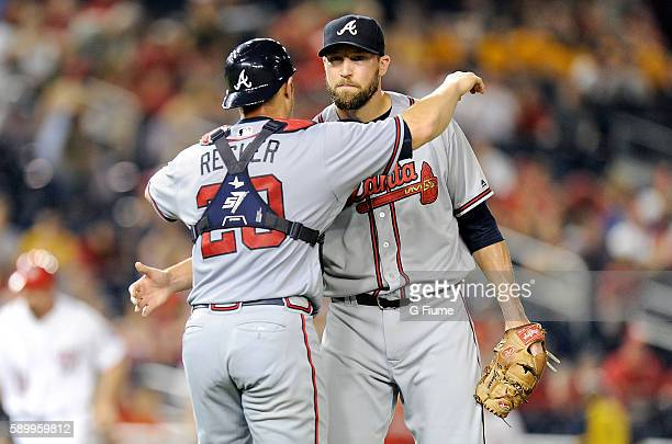 Jim Johnson of the Atlanta Braves celebrates with Anthony Recker after a 85 victory against the Washington Nationals at Nationals Park on August 12...