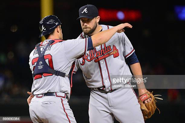 Jim Johnson of the Atlanta Braves hugs Anthony Recker after closing out the game against the Arizona Diamondbacks at Chase Field on August 25 2016 in...