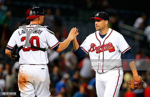 Jim Johnson of the Atlanta Braves reacts after their 43 win over the Los Angeles Dodgers with Ryan Lavarnway at Turner Field on July 21 2015 in...