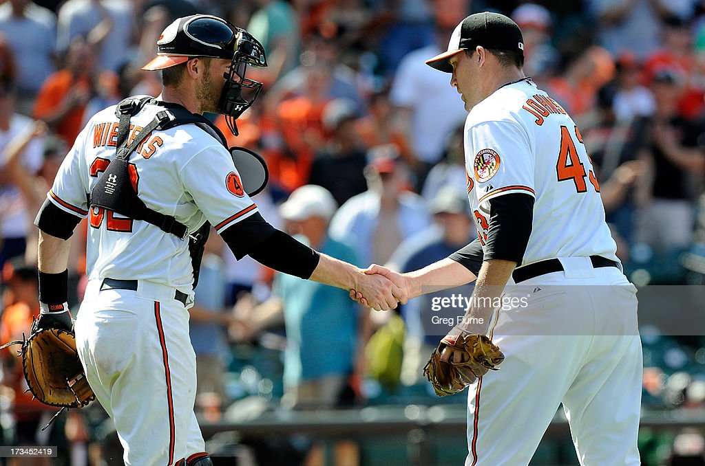 Jim Johnson #43 of the Baltimore Orioles celebrates with <a gi-track='captionPersonalityLinkClicked' href=/galleries/search?phrase=Matt+Wieters&family=editorial&specificpeople=4498276 ng-click='$event.stopPropagation()'>Matt Wieters</a> #32 after a 7-4 victory against the Toronto Blue Jays at Oriole Park at Camden Yards on July 14, 2013 in Baltimore, Maryland.