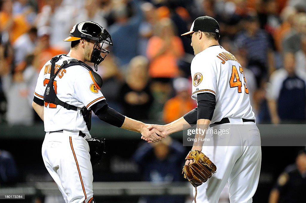 Jim Johnson #43 of the Baltimore Orioles celebrates with <a gi-track='captionPersonalityLinkClicked' href=/galleries/search?phrase=Matt+Wieters&family=editorial&specificpeople=4498276 ng-click='$event.stopPropagation()'>Matt Wieters</a> #43 after a 4-2 victory against the New York Yankees at Oriole Park at Camden Yards on September 9, 2013 in Baltimore, Maryland.