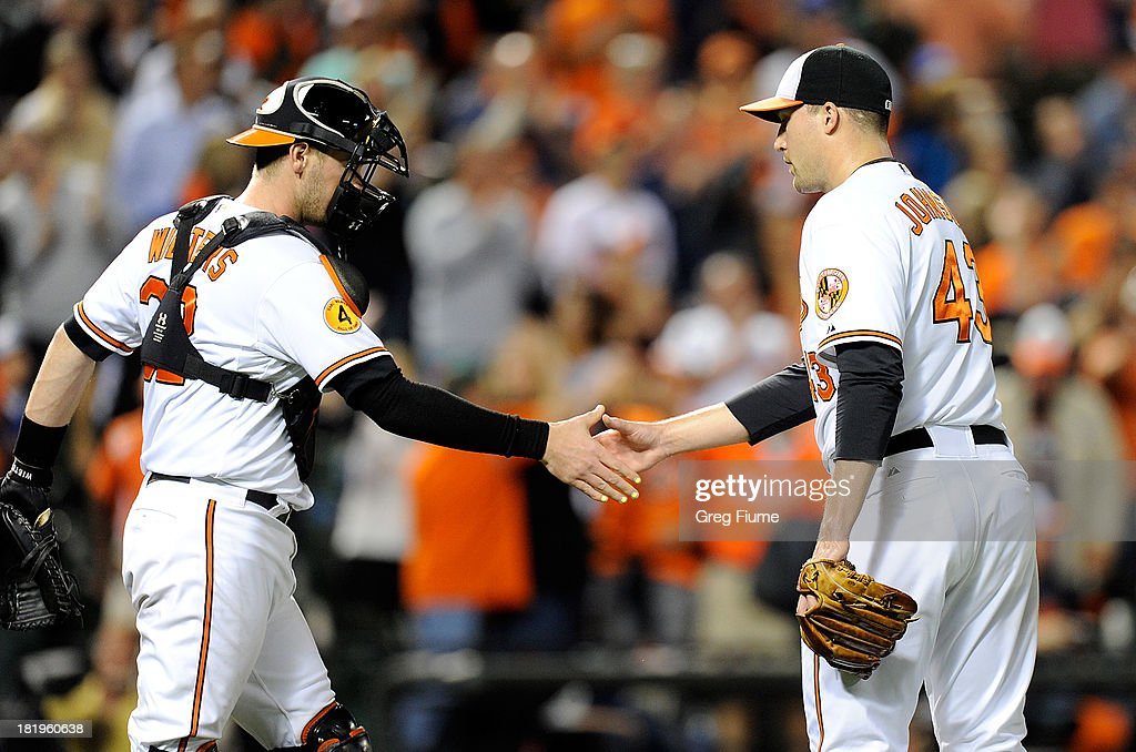 Jim Johnson #43 of the Baltimore Orioles celebrates with <a gi-track='captionPersonalityLinkClicked' href=/galleries/search?phrase=Matt+Wieters&family=editorial&specificpeople=4498276 ng-click='$event.stopPropagation()'>Matt Wieters</a> #32 after a 3-2 victory against the Toronto Blue Jays at Oriole Park at Camden Yards on September 26, 2013 in Baltimore, Maryland.
