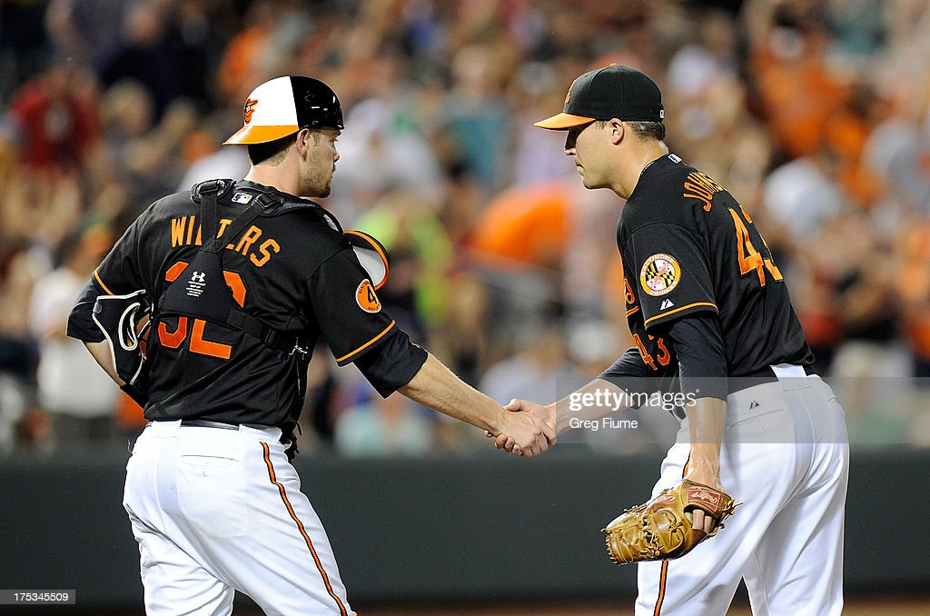 Jim Johnson #43 of the Baltimore Orioles celebrates with <a gi-track='captionPersonalityLinkClicked' href=/galleries/search?phrase=Matt+Wieters&family=editorial&specificpeople=4498276 ng-click='$event.stopPropagation()'>Matt Wieters</a> #32 after an 11-8 victory against the Seattle Mariners at Oriole Park at Camden Yards on August 2, 2013 in Baltimore, Maryland.