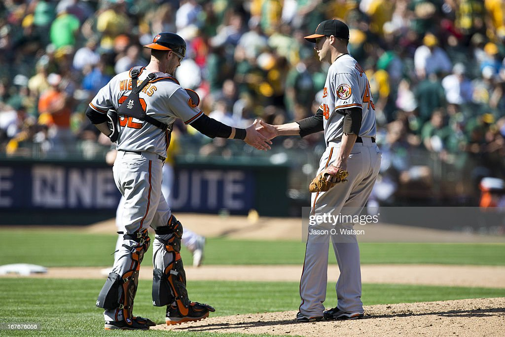 Jim Johnson #43 of the Baltimore Orioles celebrates with <a gi-track='captionPersonalityLinkClicked' href=/galleries/search?phrase=Matt+Wieters&family=editorial&specificpeople=4498276 ng-click='$event.stopPropagation()'>Matt Wieters</a> #32 after the game against the Oakland Athletics at O.co Coliseum on April 27, 2013 in Oakland, California. The Baltimore Orioles defeated the Oakland Athletics 7-3.